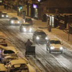 Motorists make their way home in the snow in the early hours of the morning in the Rathmines area of Dublin.