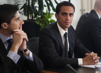 Alberto Contador and his lawyer Andy Ramos, left, wait for this morning's CAS hearing to begin.
