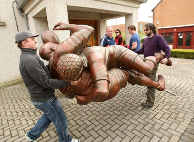 Declan Kidney watches as a temporary statue created to promote the Heineken Cup is moved into place (file photo).