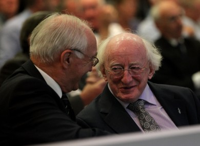 Michael D. Higgins (right) chats with former FAI President David Blood at this year's FAI AGM in Ennis.