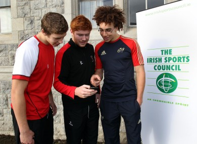 Matthew Rea, Conor Joyce and Ultan Dilhane check out the Irish Sports Council's Anti-Doping Android App at the U19 IRFU National Age Grade Talent Camp in Clongowes Wood College.