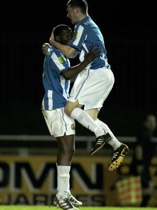 Monaghan United goalscorer Michael Isichei is congratulated by teammate Ryan Brennan.