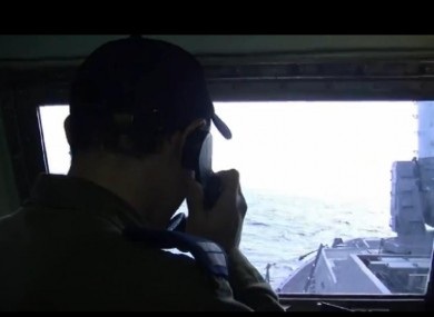 IDF personnel issue a warning to the two boats