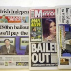 22 November 2010: Pictured is a selection of newspapers the day after the governemt announce their application for a bailout. (Photocall Ireland)