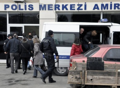 Passengers of the hijacked boat return to a security office in Silivri.