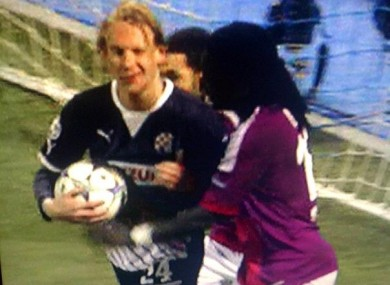Dinamo Zagreb defender Domagoj Vida appears to wink and give Bafetimbi Gomis the 'thumbs up' after one of the Lyon striker's four goals last night