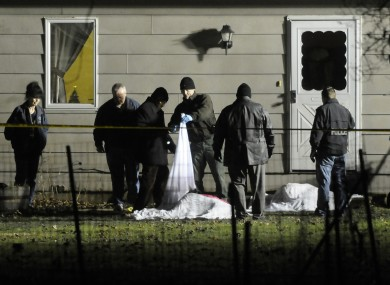 Investigators work at the scene of a murder/suicide in the small town of Emington, south of Dwight, Illinois Friday night