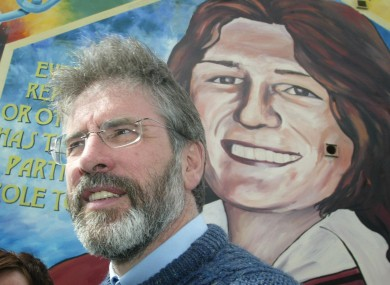 Adams pictured in front of a mural of Sands in 2005