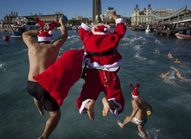 Athletes dressed as Santa Claus jump on the Mediterraean sea as they take part in the Copa Nadal held annually in Barcelona.