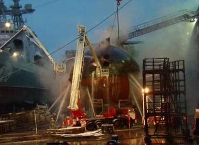 Firefighters spray water on the nuclear sub earlier today