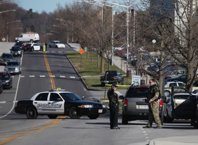 Police officers block a road on the Virginia Tech campus in Blacksburg, Virginia