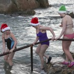 Three local ladies brave the icy sea for the traditional Christmas Day swim at the Forty Foot in Sandycove. (Image: Conor McCabe Photography)
