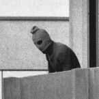 A hooded member of the Palestinian terrorist group which held members of the Israeli Olympic team hostage in the Munich Olympic village - they killed 11 athletes and coaches.
