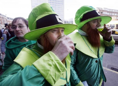 Leprechauns drinking something green and possibly alcoholic