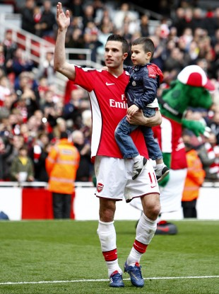 New signing? Robin and Shaqeel van Persie greet the Emirates crowd.