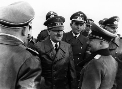 Adolf Hitler, centre, during a military review in April 1944.