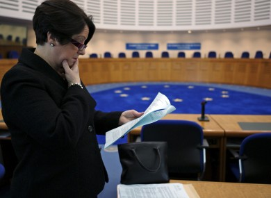 Carmel Stewart, a lawyer for A B and C, reads the ECHR's ruling at its courtroom in Strasbourg.