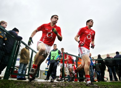 Cork's Kevin Harrington and Conor O'Driscoll take to the field in Clonmel yesterday.