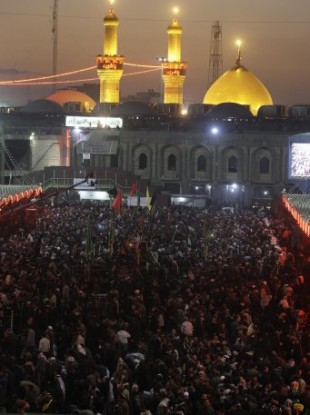 Shiite faithful pilgrims gather in front of the Imam Hussein Shrine in Karbala for Arbaeen.
