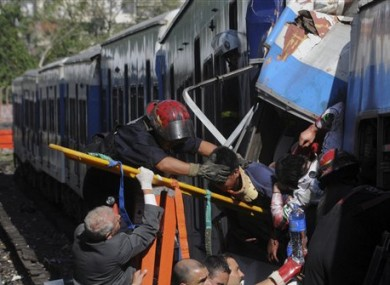 Firemen rescue injured passengers from the crashed train in Buenos Aires.