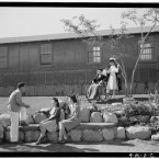 Nurse Aiko Hamaguchi with patient Tom Kano, in wheelchair, as George Nakano, Keiko Kamahara and Fuimi Tashima speak on the bench below. (Library of Congress, Prints & Photographs Division)