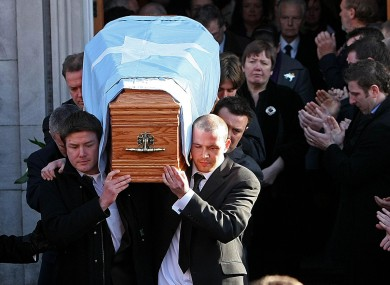 Shane Geoghegan's relatives carry his remains at the funeral in November 2008