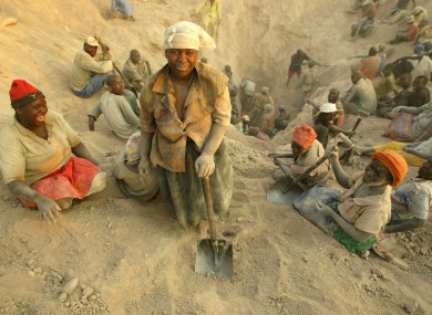 Nov. 1, 2006 file photo miners dig for diamonds in Marange, eastern Zimbabwe