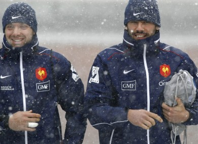 Vincent Clerc, left, and former French team-mate Clement Poitrenaud arrive for training in the snow.
