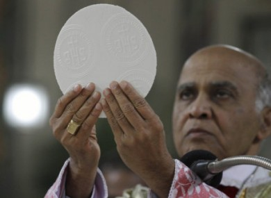 A priest in India celebrating Christmas mass in December 2010.