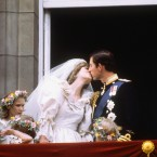 The early 1980s brought need entrants to the Royal Family - including Lady Diana Spencer, who married Prince Charles on July 29, 1981. Here the Queen manages not to notice Charles and Diana's legendary kiss.