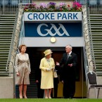Later the Royal couple historically visited Croke Park to get to grips with Ireland's native sports. Pictured alongside the Queen and President McAleese is GAA president Christy Cooney.