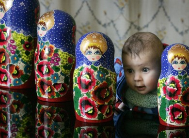 Five-month-old Rodan Rakhmatullin, from Lucan, meets four Russian dolls at the launch of Dublin's Festival of Russian Culture