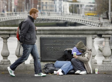 A couple keeping warm on O'Connell  Bridge
