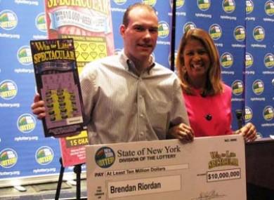 Brendan Riordan collects his cheque for $10 million, from NY Lottery's Youlanda Vega.