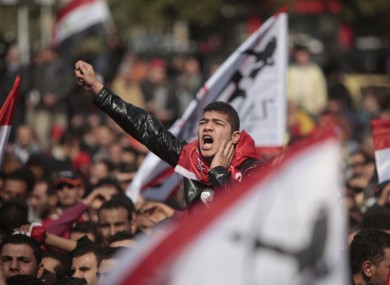 An Egyptian soccer fan shouts anti-ruling military council slogans during a protest at Sphinx square in Cairo today.