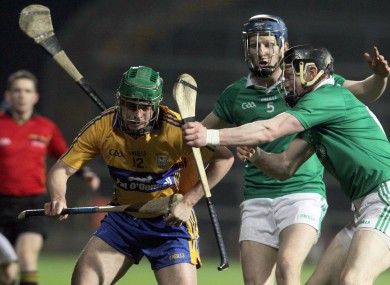 Clare's Sean Collins with Wayne McNamara and Connor Allis of Limerick