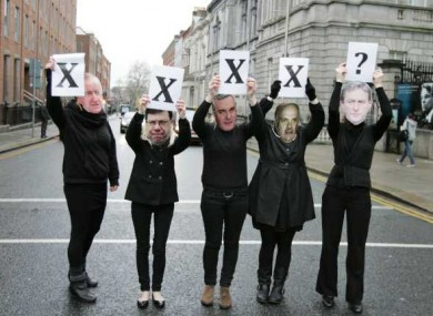 Members of Action on X - wearing masks of former Taoisigh who failed to legislate for the X case ruling - protest at the Dáil yesterday.