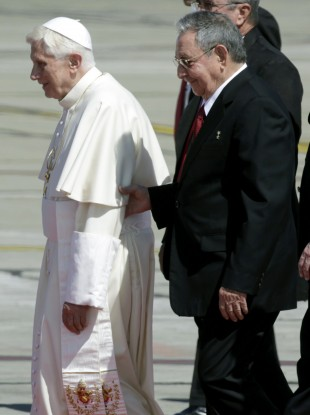 Pope Benedict XVI walks with Cuba's President Raul Castro