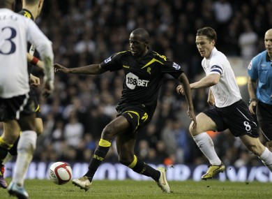 Fabrice Muamba controls the ball beside Tottenham Hotspur skipper Scott Parker.