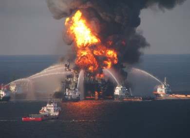 Firefighting ships attempt to put out the flames on the burning rig