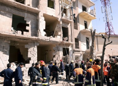 s Syrian rescue teams investigating the scene after an explosion in a residential neighborhood in Aleppo, Syria, on Sunday