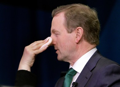 Enda gets a touch-up during his US St Patrick's Day trip.