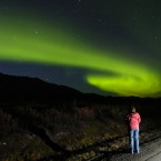 A spectator watches the aurora borealis rise above the Alaska Range in 2006. (AP Photo/M. Scott Moon, File)