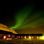 The Northern Lights dance over the Spitsbergen Hotel in Longyearbyen, Norway in 2008. (AP Photo/John McConnico)