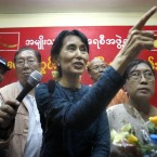 Burma's pro-democracy leader Aung San Suu Kyi is released from house arrest after seven years. (AP Photo/PA)