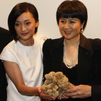 Angela Leong, right, wife of Macau tycoon Stanley Ho, holding the 1.5kg white truffle, celebrates with Mainland China's actress Zhou Xun after won the bid for US$330,000 during an auction in 2007. (AP Photo/Ho Chon In)