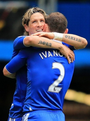 The striker hugs team-mate Branislav Ivanovic.