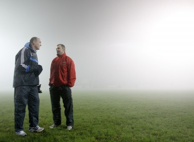 Dublin manager Pat Gilroy and Mayo manager James Horan talk after last month's game was called off at half-time due to poor visibility.