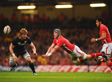 Dan Lydiate, centre, spreads the ball during his man-of-the-match performance against Scotland.