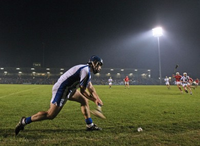 Waterford's Jamie Nagle takes a sideline cut against Cork.